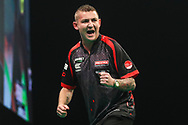 Nathan Aspinall hits a double and wins a leg and celebrates during the Unibet Premier League darts at Motorpoint Arena, Cardiff, Wales on 20 February 2020.