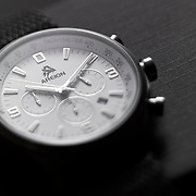 White faced chronograph Areion watch on a gray background.