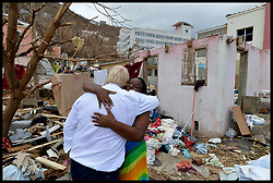 September 13, 2017 - Caribbean, Caribbean, Anguilla - UK Foreign secretary BORIS JOHNSON hugs a woman on the British Virgin Islands during a visit after Irma storm hit islands of British Virgin Islands and Anguilla which have been hit by Hurricane Irma.  (Credit Image: © Andrew Parsons/i-Images via ZUMA Press)