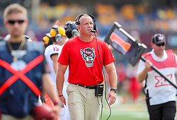 Sep 14, 2019; Morgantown, WV, USA; North Carolina State Wolfpack head coach Dave Doeren walks along the sidelines during the second quarter against the West Virginia Mountaineers at Mountaineer Field at Milan Puskar Stadium. Mandatory Credit: Ben Queen-USA TODAY Sports