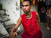 25 SEPTEMBER 2016 - BANGKOK, THAILAND: A resident of the Pom Mahakan community poses for tourists before a Likay performance in the old fort. Forty-four families still live in the Pom Mahakan Fort community. The city of Bangkok has given them provisional permission to stay, but city officials say the permission could be rescinded and the city go ahead with the evictions. The residents of the historic fort have barricaded most of the gates into the fort and are joined every day by community activists from around Bangkok who support their efforts to stay.      PHOTO BY JACK KURTZ