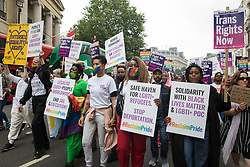 London, UK. 24th July, 2021. Peter Tatchell (l), veteran LGBTI+ and human rights campaigner, leads thousands of LGBTI+ protesters taking part in the first-ever Reclaim Pride march. Reclaim Pride replaced the traditional Pride in London march, which many feel has become too commercial and strayed from its roots in protest, and was billed as a People's Pride march for LGBTI+ liberation.