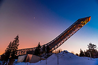The world famous Holmenkollen  ski jump, Oslo, Norway (aka Holmenkollbakken.) It has been a site for ski jumping since 1892. Between 2009 and 2010 the entire structure was demolished and rebuilt. It has been the site of numerous world championships and FIS Ski Jumping World Cup Events and was used in 1952 Winter Olympics.