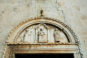 Portal of church of Sveti Duje (Saint Dominic) Monastery, showing a Bishop (possibly Sveti Duje), Holy Virgin with Child, and Mary Magdalene . Trogir, Croatia