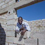 INDIVIDUAL(S) PHOTOGRAPHED: Samson Msimuko. LOCATION: Lusaka, Zambia. CAPTION: Samson Msimuko at one of his construction sites in Lusaka, Zambia. Samson completed his bricklaying training at the Build It Centre of Excellence with Build It International, a charity that trains unemployed young people in Zambia to become builders, while at the same time building vital schools and clinics in communities with little or nothing by way of resources.