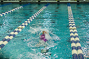 Claire Bosse competes in the 100 Yard Backstroke in the 2016 NYSPHSAA Swimming and Diving Championships held at Ithaca College on Saturday.