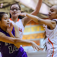 Miyamura Patriot Lauren Thomas (14) passes the ball away from Gallup Bengal McKleigh Begaye (25) Monday at Gallup High School.