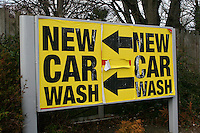 Pasted up sign for car wash at a garage