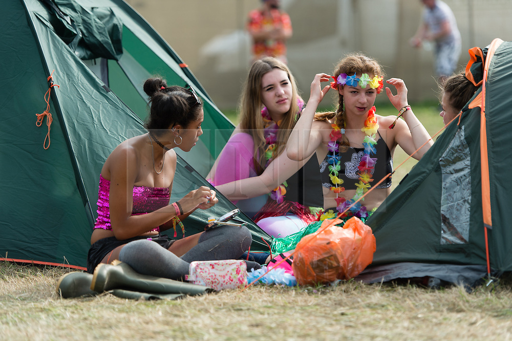 © Licensed to London News Pictures. 06/09/2014. Isle of Wight, UK. Festival goers at Bestival 2014 Day 3 Saturday do their hair and makeup and get their fancy dress outfits ready.  Today is the festival's Fancy Dress Day - this year the theme is Desert Island Disco.  Festival goers spend the morning readying their costumes before the judging of the competition at 2pm.  This weekend's headliners include Chic featuring Nile Rodgers, Foals and Outcast.   Bestival is a four-day music festival held at the Robin Hill country park on the Isle of Wight, England. It has been held annually in late summer since 2004.    Photo credit : Richard Isaac/LNP