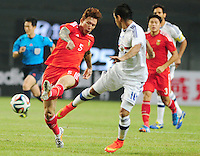 Zhang Linpeng of China, left, shoots against Paraguay during a friendly football match in Changsha city, central China's Hunan province, 14 October 2014.<br /> <br /> Paraguay's dismal run of form continued as they suffered a 2-1 friendly defeat to China on Tuesday (14 October 2014). The South American nation, who came into the game having won two of their previous 13 fixtures, fell short in their bid to pull off a late comeback at Changsha's Helong Stadium. In contrast to their opponents, China have now lost just two of their last 16 matches as they continue to build towards next year's AFC Asian Cup in Australia.
