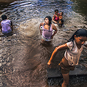 Girls playing in the river on the road to Cucuì, triple border between Brazil, Colombia and Venezuela