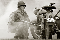 Kneeling behind a BMW motorbike and sidecar 82nd 505th PIR with Thompson Sub machinegun take part in a Battle reenactment - Nww2A Fort Paull<br /> <br />  Copyright Paul David Drabble<br /> 5th & 6th May 2019<br />  www.pauldaviddrabble.co.uk