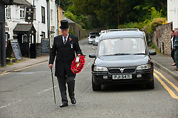 © Licensed to London News Pictures. 16/05/2014. Kington, UK. The cortege arrives in Church Street. The funeral cortege of Lance Corporal Oliver Thomas, who was born in Brecon, Powys, Wales, passes through the smalL town of Kington, Herefordshire where the 26-year-old went to school. L/Cpl Oliver Thomas died alongside, Capt Thomas Clarke, Warrant Officer Spencer Faulkner, Cpl James Walters and Flt Lt Rakesh Chauhan, when their Lynx helicopter crashed in Kandahar, southern Afghanistan last month. L/Cpl Thomas was a researcher for the MP for Brecon and Radnorshire, Roger Williams. Photo credit : Graham M. Lawrence/LNP