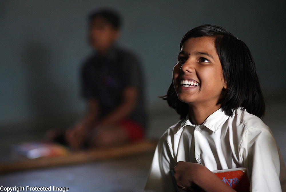 Vidhyashree Doomani, 14, attends extra English classes at the Vimochana School in Malabad, India.  The school was the first residential school for the children of Devadasis and was founded in 1990 to break the cycle of the Devadasi system.  Because the belief is that all female children of Devadasis should themselves become Devadasis, the school was created to remove the children from the culture in which this practice took place and instead offer them an education.  All students receive free tuition, books, uniforms, food and medical care. While Doomani's mother is a Devadasi, Vidhyashree hopes to become a teacher after graduation.