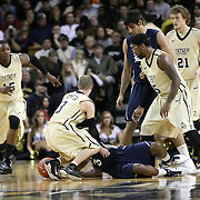 Central Florida guard Marcus Jordan (5) and Central Florida guard A.J. Rompza (3) struggle with Tamir Jackson (3) for the ball during a Conference USA NCAA basketball game between the Rice Owls and the Central Florida Knights at the UCF Arena on January 22, 2011 in Orlando, Florida. Rice won the game 57-50 and extended the Knights losing streak to 4 games.  (AP Photo/Alex Menendez)