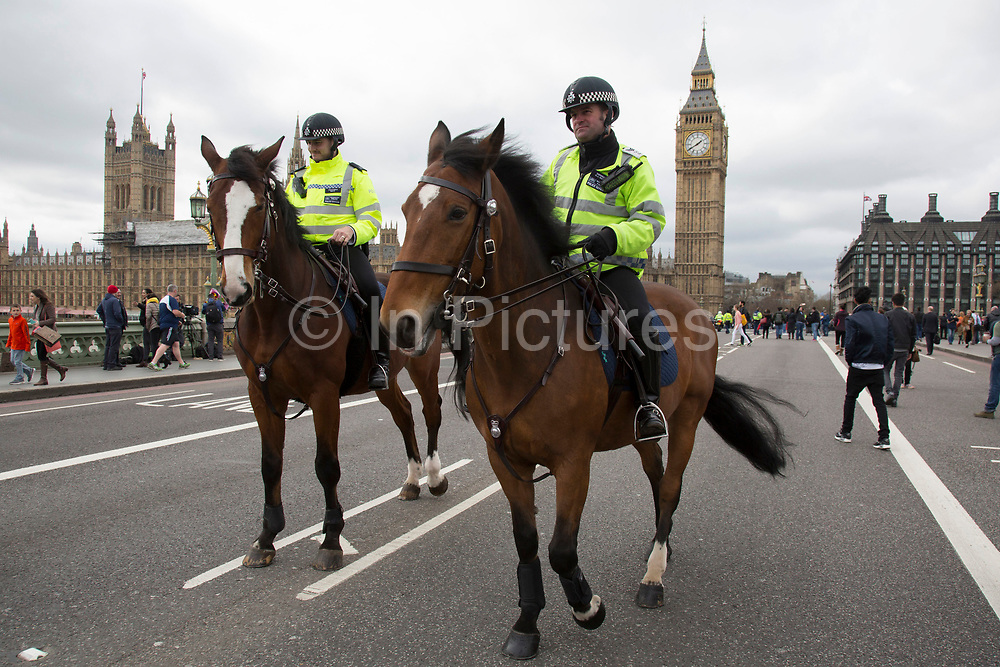 Thousands of people including mounted police officers and Muslim faith leaders gathered on Westminster Bridge to hold a vigil and a minutes silence one week after the terror attack, on March 29th 2017 in London, United Kingdom.