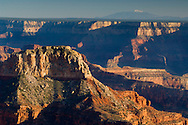 San Francisco Peaks as seen over the cliffs of South Rim, as seen from Point Sublime on the North Rim, Grand Canyon National Park, Arizona