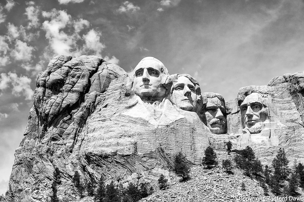 Mount Rushmore is located in the Black Hills of South Dakota. It was once land that belonged to the Lakota Sioux people, given to them in a U.S. treaty in 1868. As usual with the American government, they reneged on the treaty was gold was discover in the hills, forcing the Sioux to relinquish the territory. The government then carved the faces of four presidents into the hills as one remaining insult. Work began in 1927 and ended in 1941.