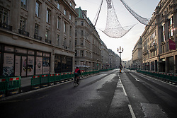 © Licensed to London News Pictures. 08/11/2020. London, UK. A member of the public cycles down a quiet Regent Street in Central London. A national lockdown has been put in place in an attempt to fight a second wave of the COVID-19 strain of Coronavirus. Photo credit: George Cracknell Wright/LNP
