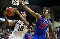 Texas A&M center Tonny Trocha-Morelos (10) and Florida forward Keith Stone (25) go after a rebound during the first half of an NCAA college basketball game Tuesday, Jan. 2, 2018, in College Station, Texas. (AP Photo/Sam Craft)