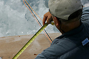 Angler prepping offshore fly fishing leader.