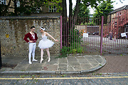 Ballet dancers from the Ruggieri Dance Academy practice their positions in an unexpected urban environment prior to a performance at a local Summer event in Wapping, London, England, United Kingdom.