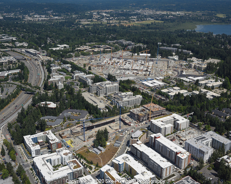 Aerial view of construction activity in the Overlake neighborhood of Redmond, Washington. Visible in this photo are the Sound Transit East Link Extension project, along State Route 520, Esterra Park transit-oriented development in the foreground, and the Microsoft Redmond campus modernization project.