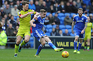Cardiff City's Joe Ralls (c) passes under a challenge from Rotherham's Richard Smallwood. EFL Skybet championship match, Cardiff city v Rotherham Utd at the Cardiff city stadium in Cardiff, South Wales on Saturday 18th February 2017.<br /> pic by Carl Robertson, Andrew Orchard sports photography.