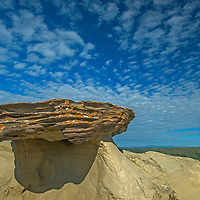 Clouds float over an eroded rock feature in Charles M. Russell National Wildlife Reserve, Montana.