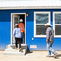 082714      Cayla Nimmo<br /> <br /> The Largo residence held an open house Wednesday afternoon in Pinedale. Constrction workers, politicians, and family members all came out in support of the the first veterans housing project to be completed in Eastern Navajo.