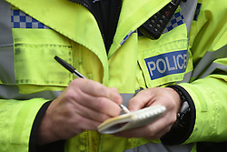 File photo dated 22/10/14 of a police officer, as police officer numbers have fallen to the lowest level in more than 30 years, new figures show.