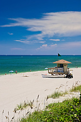 lifeguard huts with rescue boat and dune buggy, stakes with yellow tags marking turtle nests, Juno Beach, one of the most productive sea turtle nesting sites in the world, Florida, Atlantic Ocean