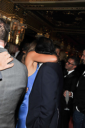 ELIZABETH HURLEY and ARUN NAYAR at the 50th birthday party for Patrick Cox held at the Café Royal Hotel, 68 Regent Street, London on 15th March 2013.