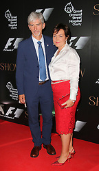 © Licensed to London News Pictures. 02/07/2014, UK. Damon Hill; Georgie Hill, F1 Party in aid of Great Ormond Street Hospital Children's Charity, Victoria and Albert Museum, London UK, 02 July 2014. Photo credit : Richard Goldschmidt/Piqtured/LNP