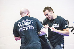 Students practising their punches onto the pads. Stef Noij, KMG Instructor from the Institute Krav Maga Netherlands, takes the IKMS G Level Programme seminar today at the Scottish Martial Arts Centre, Alloa.