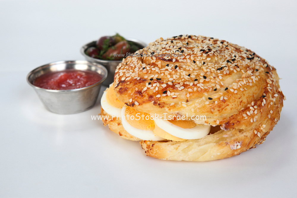 Borek (Also Burek) a Turkish pastry filled with cheese or potato or mushroom with hard boiled egg