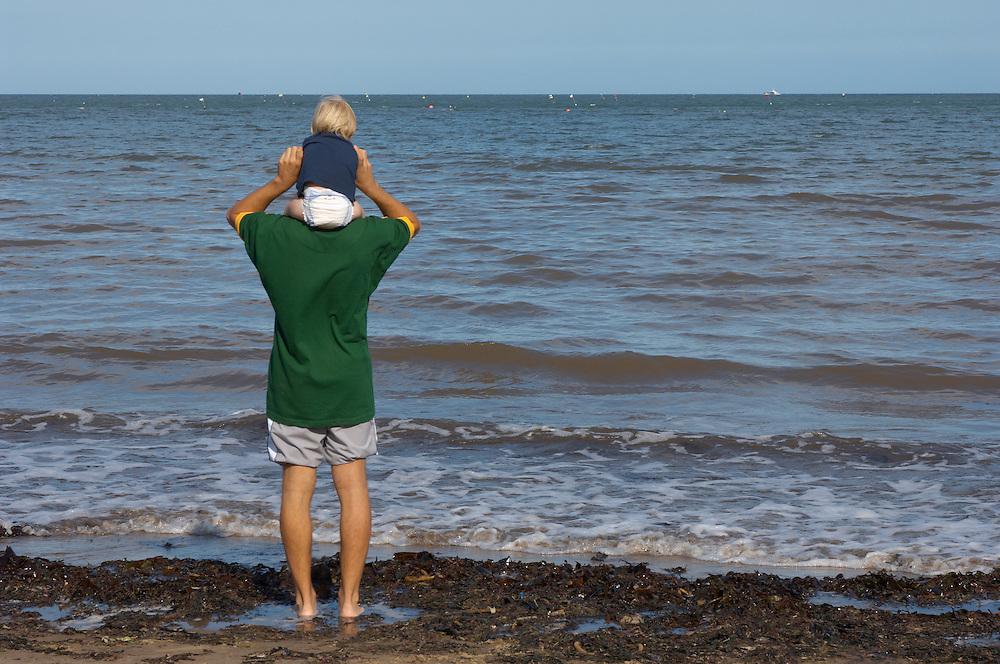 Runswick Bay - North Yorkshire - England - man and baby