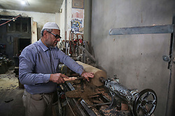 December 17, 2018 - Gaza City, The Gaza Strip, Palestine - Mohammed Hassouneh 62 years old Palestinian from Gaza city, Hassouneh works in wood decoration, he decorate mosques and made gifts. (Credit Image: © Hassan Jedi/Quds Net News via ZUMA Wire)