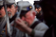 54th Massachusetts Infantry's Donel Singleton, 31, of Charleston looks on as members of the Palmetto Battalion prepare for the  'Voices From the Civil War' event on the Battery in Charleston as part  of the 150th anniversary of the start of the Civil War. <br /> Charleston, S.C. 04-11-2011. C. Aluka Berry - The State Media Company