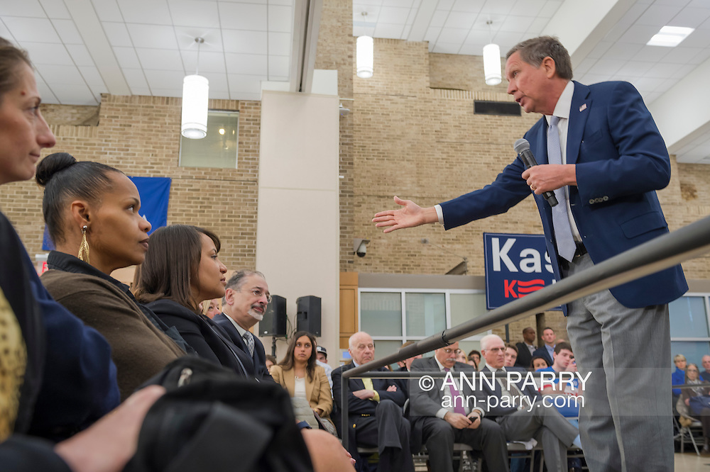 Hempstead, New York, USA. April 4, 2016. JOHN KASICH, Republican presidential candidate and governor of Ohio, hosts a Town Hall at Hofstra University David Mack Student Center in Long Island. He held his hand out while asking an audience member a question. The New York primary is April 19, and Kasich is the first of the three GOP presidential candidates to campaign in Nassau and Suffolk Counties, and is in third place in number of delegates won.