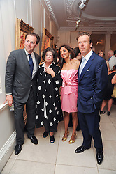 Left to right, SIMON DAVIS, FAY MASCHLER, DIVIA CADBURY and JOEL CADBURY at a party to celebrate the launch of Page One an online guide to London's 100 most rewarding restaurants held at the Halcyon Gallery, Bruton Street, London on 7th July 2010.