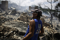 December 12, 2016 - Recife, Brazil - During the morning of Monday (12), the fire hit the favela Vila Santa Luzia, in the city of Recife. Dozens of people had their homes burned by fire and three men had severe burns on their bodies. In Recife, Northeast Brazil, December 12, 2016. (Credit Image: © Diego Herculano/NurPhoto via ZUMA Press)