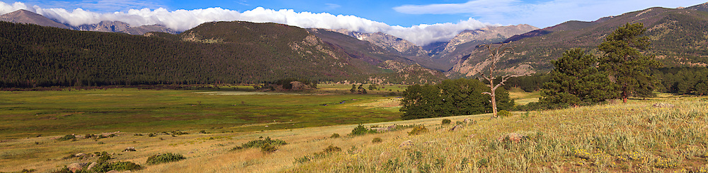 Cloud covered mountains overlook a tranquil meadow and stream in Rocky Mountain National Park near Estes Park, Colorado. WATERMARKS WILL NOT APPEAR ON PRINTS OR LICENSED IMAGES.