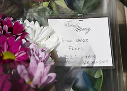 © Licensed to London News Pictures. 05/04/2018. London, UK. A note on flowers left in tribute, says 'Little Shegz from Big Shegz' - near where a police tent covers a murder scene in Hackney after a 20 year old man was stabbed in Link Street. Police were approached by a man suffering from stab injuries at 8pm last night he was pronounced dead at 8. 24pm by officers. Photo credit: Peter Macdiarmid/LNP