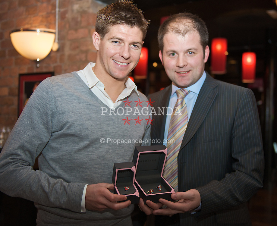 LIVERPOOL, ENGLAND - Wednesday, March 19, 2008: Steven Gerrard is presented with customised cufflinks for the SoccerAid Charity by Boodles. (Photo by David Rawcliffe/Propaganda)