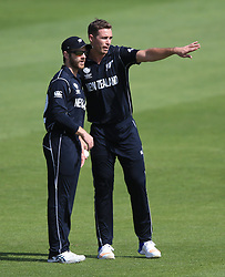New Zealand's Tim Southee (right) talks to Kane Williamson during the ICC Champions Trophy, Group A match at Sophia Gardens, Cardiff.