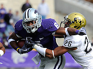 MANHATTAN, KS - OCTOBER 24:  Running back Daniel Thomas #8 of the Kansas State Wildcats fights through the tackle of safety Ray Polk #26 of the Colorado Buffaloes in the first quarter on October 24, 2009 at Bill Snyder Family Stadium in Manhattan, Kansas.  (Photo by Peter G. Aiken/Getty Images)
