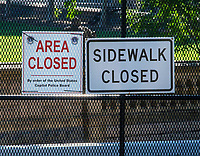 Signs on Fence Around the Capitol,, Washington DC still almost deserted with the ongoing covid pandemic photo by Catherine Brown