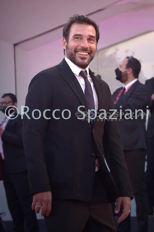 "VENICE, ITALY - SEPTEMBER 10: Edoardo Leo walks the red carpet ahead of the movie ""Nuevo Orden"" (New Order) at the 77th Venice Film Festival on September 10, 2020 in Venice, Italy.<br /> (Photo by Rocco Spaziani)"