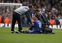 Photo: Rich Eaton.<br /> <br /> Chelsea v Arsenal. Carling Cup Final. 25/02/2007. Wayne Bridge of Chelsea receives treatment after the second half brawl